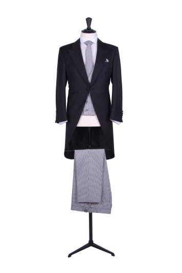 Slim fit tailcoat black with dogtooth trousers to hire.