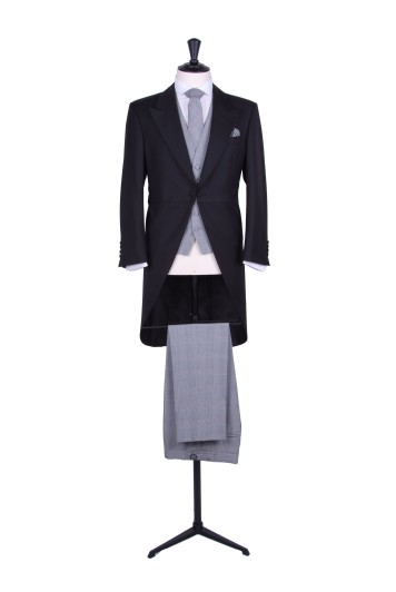 Slim fit black tailcoat with Prince of  Wales trousers to hire.