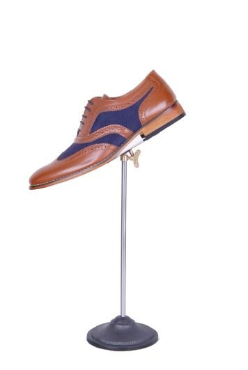 Tan and navy brogue shoes